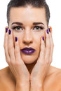 Graceful attractive woman with purple lips and nails portrait isolated Stock Image