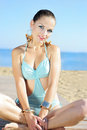 Graceful girl in blue swimsuit ashore epidemic deathes the concerns with yoga Stock Photos