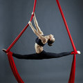 Graceful gymnast performing aerial exercise image of Stock Photo