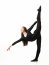 Graceful gymnast young beautiful female stretching out on white background Stock Image