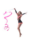 Graceful little gymnast dancing with ribbon in studio Stock Photography