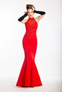 Graceful newlywed in red dress. Luxury Stock Images