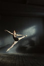 Graceful principal ballet dancer performing in the air