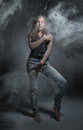 Graceful woman dancing in the cloud of dust. Gray background Royalty Free Stock Photo