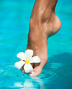Graceful womans leg touching water skin care Royalty Free Stock Photography