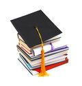 Grad hat and diploma with books on white Stock Image