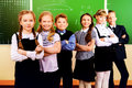 Grade school happy schoolchildren at a classroom education Royalty Free Stock Photo
