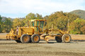 Grader land working the building pad of a new tennis court in roseburg oregon at stewart park Royalty Free Stock Image