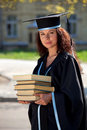 The graduate with books Royalty Free Stock Photos