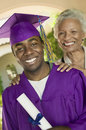 Graduate and happy grandmother portrait of a male with his standing outside Stock Photography
