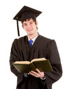 Graduate holding a book Royalty Free Stock Photo