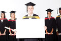 Graduate holding white board Royalty Free Stock Images