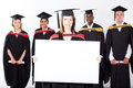 Graduate holding white board Royalty Free Stock Photos