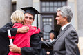 Graduate hugging mother happy male his at graduation ceremony Royalty Free Stock Photos