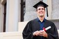 Graduate outside college building cheerful male Royalty Free Stock Photography