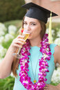 Graduate Sipping Wine Royalty Free Stock Photo