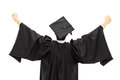 Graduate student in graduation gown with raised hands rear view isolated on white background Royalty Free Stock Image