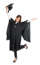 Graduate student jumping full body excited asian female in graduation gown hands raised open arms isolated on white background Royalty Free Stock Image