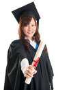 Graduate student showing graduation diploma portrait of smiling asian female in gown isolated on white background Royalty Free Stock Image