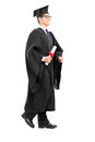 Graduate student walking with diploma in his hand isolated on white background Royalty Free Stock Image