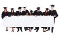 Graduate students holding empty banner isolated on white Royalty Free Stock Photography