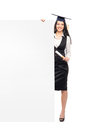 A graduate woman holding a white banner young beautiful and happy girl with blank isolated on Royalty Free Stock Photos