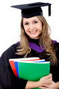 Graduated woman with books Royalty Free Stock Photography
