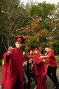 Graduates with cap and gown Royalty Free Stock Photo