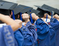 Graduates put hands up back of during commencement Royalty Free Stock Photo