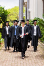 Graduates walking ceremony group of happy to graduation Stock Images