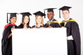 Graduates with white board Royalty Free Stock Photo