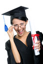 Graduating student in glasses with the certificate spectacles diploma adjusts spectacles isolated on white Royalty Free Stock Image