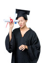Graduating student keeps diploma like the telescope isolated on white Royalty Free Stock Photo