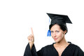 Graduating student making the attention gesture in black academic gown and cap isolated on white Stock Photo
