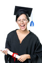 Graduating student in spectacles with the diploma and academic gown isolated on white Stock Photos
