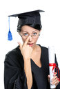 Graduating student in spectacles glasses with the diploma adjusts the isolated on white Royalty Free Stock Photography
