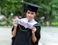 Graduation asian girls with congratulation in thai wording Stock Photography