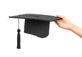 Graduation cap hand white background Stock Photo