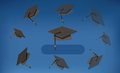 Graduation Caps - Black Mortarboards Thrown in the Air Royalty Free Stock Photo