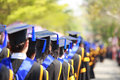 Graduation crowd image of students at ceremony from behind Royalty Free Stock Image