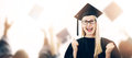 Graduation - happy graduate wearing gown and hat Royalty Free Stock Photo