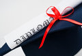 Graduation hat diploma red ribbon Royalty Free Stock Images