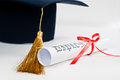 Graduation hat diploma red ribbon Stock Image