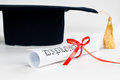 Graduation hat diploma red ribbon Royalty Free Stock Photo