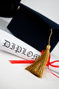 Graduation hat diploma red ribbon Royalty Free Stock Photography