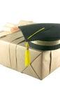Graduation hat on gift box Royalty Free Stock Photo