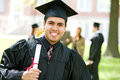 Graduation hispanic student happy to graduate extensive series of recent graduates after outside with friends muti ethnic group Royalty Free Stock Image