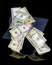 Graduation money gift coming out of cap Royalty Free Stock Photo