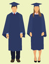 Graduation young couple wearing cap and gown for Royalty Free Stock Photography