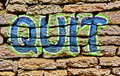 Graffiti art design quit word painted on a brick wall Royalty Free Stock Photo
